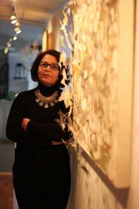 Khulood Daami at her exhibition, Iraqi Cultural Centre London, 2013